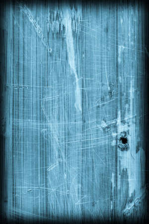 drilled: Old Blue Stained Varnished Wooden Laminated Panel, Weathered, Cracked, Scratched Vignette Grunge Texture. Stock Photo