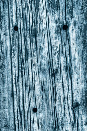 dilapidation: Old Wood, Weathered, Rotten, Cracked, Dark Pale Blue, Grunge Texture.