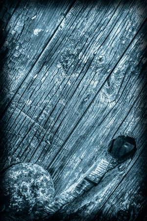 nature symbols metaphors: Old Wood, Weathered, Rotten, Cracked, Dark Pale Blue, Vignette, Grunge Texture. Stock Photo