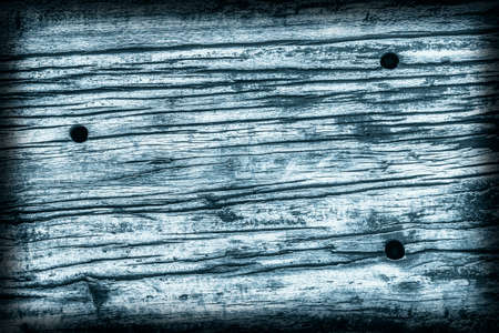 logging railroad: Old Timber Bollard, Weathered, Rotten, Cracked, Stained Dark Pale Blue, Vignette, Grunge Texture.