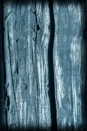 dilapidation: Old Timber Bollard, Weathered, Rotten, Cracked, Stained Dark Pale Blue, Vignette, Grunge Texture.