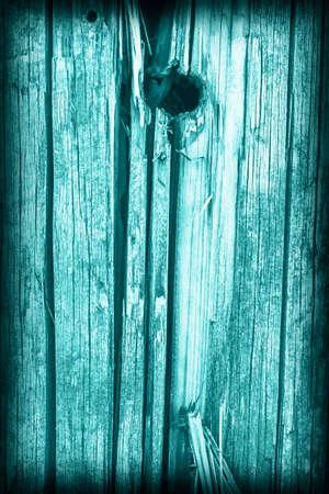 dilapidation: Old Wood, Weathered, Rotten, Cracked, Dark Pale Cyan, Vignette, Grunge Texture.
