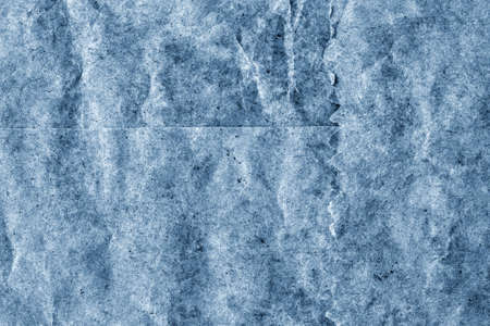 blotted: Recycle Kraft Paper, Coarse Grain, Crumpled, Blotted, Mottled, Stained Pale Powder Blue, Grunge Texture Sample.