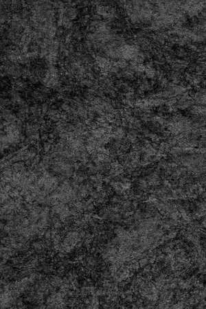 blotted: Recycle Kraft Paper, Coarse Grain, Crumpled, Blotted, Mottled, Bleached and Stained Charcoal Black, Grunge Texture Sample.