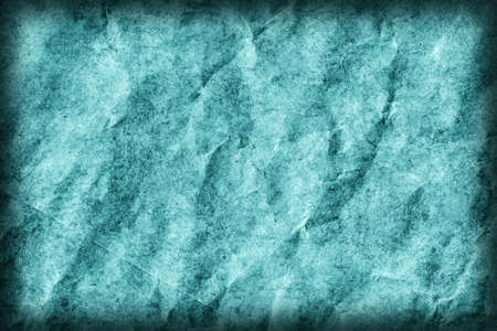 blotted: Recycle Kraft Paper, Coarse Grain, Crumpled, Blotted, Mottled, Stained Cyan, Vignette, Grunge Texture Sample. Stock Photo