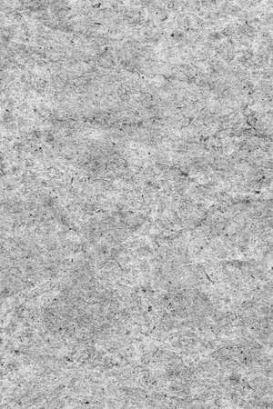 blotted: Recycle Kraft Paper, Coarse Grain, Crumpled, Blotted, Mottled, Bleached and Stained Gray, Grunge Texture Sample. Stock Photo