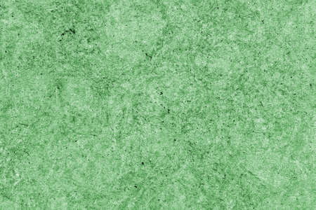 blotted: Recycle Kraft Paper, Coarse Grain, Crumpled, Blotted, Mottled, Stained Green, Grunge Texture Sample. Stock Photo