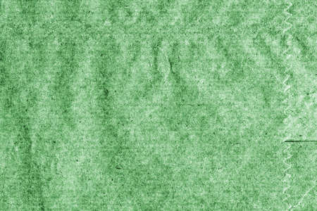 mottled: Recycle Kraft Paper, Coarse Grain, Crumpled, Blotted, Mottled, Stained Green, Vignette, Grunge Texture Sample.