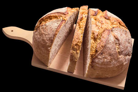 breadloaf: Monastery Bread Sliced on Wooden Cutting Board Isolated Stock Photo