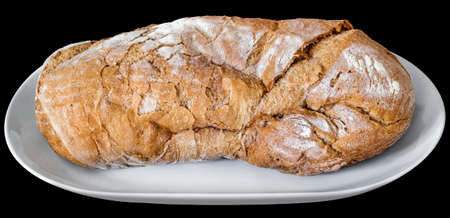 clip art wheat: Rustic Crusty Bread on White Porcelain Platter Isolated on Black Background