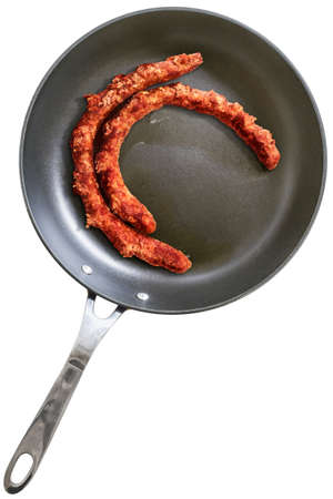 fryingpan: Fried Homemade Sausages in Teflon Frying Pan, Isolated on White Background. Stock Photo