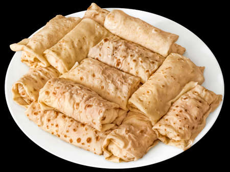 plateful: Plateful of Cheese and Ham Pancake Rolls Isolated on Black Background Stock Photo