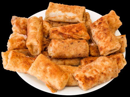 plateful: Plateful of Breaded Cheese and Ham Pancake Rolls Isolated on Black Background