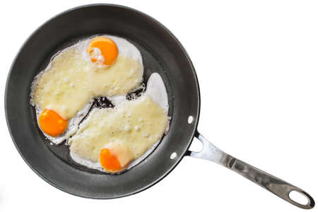 fryingpan: Fried Eggs with Edam Cheese in  Frying Pan Isolated on White Background
