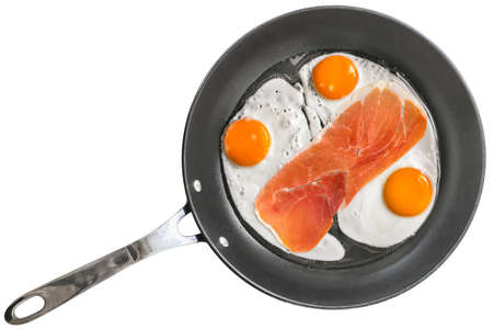 fryingpan: Fried Eggs with Smoked Pork Ham Rasher in   Frying Pan Isolated
