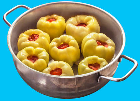 bellpepper: Uncooked Stuffed Bell Peppers in Stainless Steel Sauce Pot Isolated