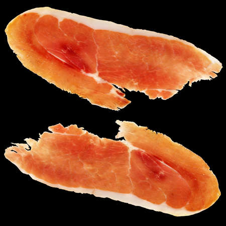 meat and alternatives: Prosciutto Smoked Pork Ham Slices Isolated on Black Background