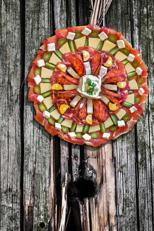 plateful: Plateful of Appetizer Savory Dish Meze Placed on Old Wood Background Stock Photo
