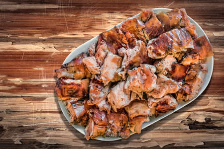 peeledoff: Plateful of Spit Roasted Pork Slices on Old Lacquered, Peeled-off Varnished Wooden Background Stock Photo