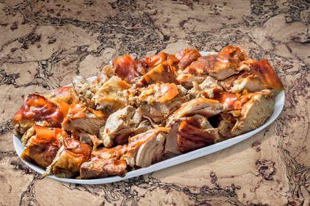 plateful: Plateful of Spit Roasted Pork Slices on Cork Tile Background Stock Photo