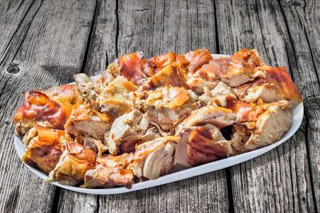 floorboards: Plateful of Spit Roasted Pork Slices on Old Wooden Floorboards