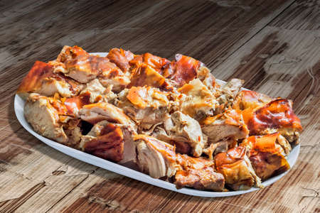 plateful: Plateful of Spit Roasted Pork Slices on Old  Lacquered Cracked Wood Background