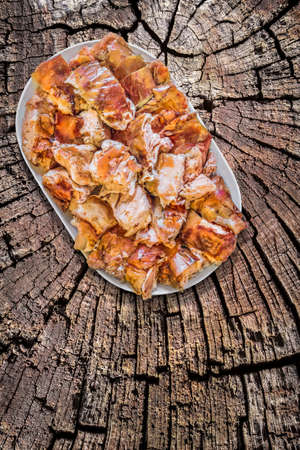 floorboards: Plateful of Spit Roasted Pork Slices on Old Weathered Wooden Floorboards Surface