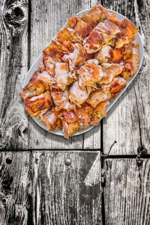plateful: Plateful of Spit Roasted Pork Slices on Old Weathered Wooden Floorboards Surface