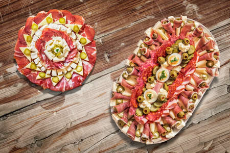 peeledoff: Appetizer Savory Dishes Meze on Old Cracked Peeled Wooden Surface