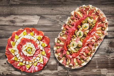 peeledoff: Appetizer Savory Dishes Meze on Old Cracked Peeled Wooden Surface