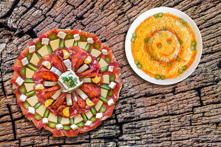 plateful: Plateful of Appetizer Meze with Bowl of Russian Salad on Old Cracked Stump