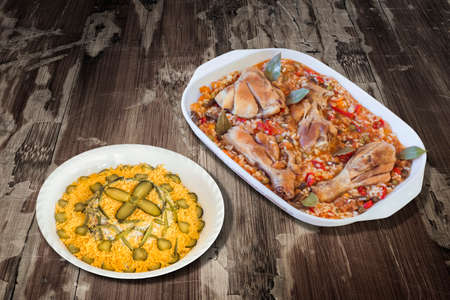 russian salad: Oven Baked Vegetable Stew with Chicken Meat and Bowl of Garnished Russian Salad on Old Wooden Table