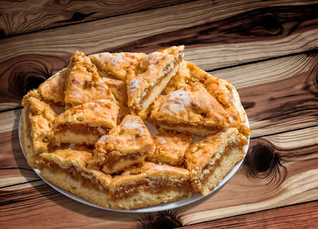 plateful: Plateful of Lazy Apple Pie Slices on Knotted Pine Wood Background Stock Photo