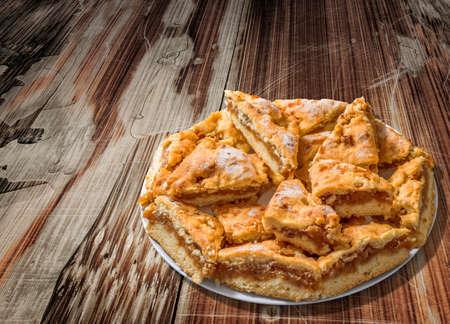 plateful: Plateful of Lazy Apple Pie Slices on Old Cracked Peeled Wood Background Stock Photo