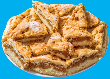 plateful: Plateful of Lazy Apple Pie Slices Isolated on Blue Background Stock Photo