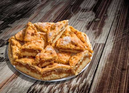 peeledoff: Plateful of Lazy Apple Pie Slices on Old Cracked Peeled Wood Background Stock Photo