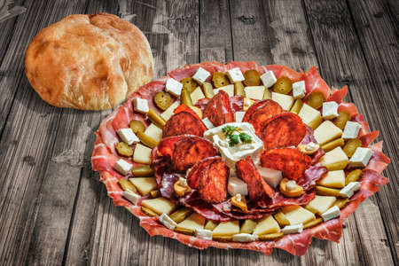 floorboards: Plateful of Serbian Appetizer Meze with Pita Bread on Old Cracked Floorboards Background