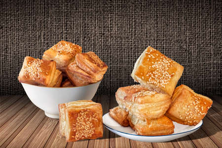 boulangerie: Square Puff Croissant Pastry on Bamboo Place Mat Background