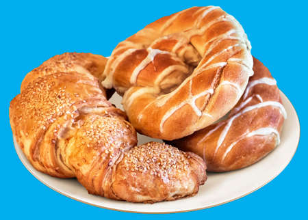 boulangerie: Plate of Pretzels and Croissant Puff Pastry Sprinkled with Sesame Seeds, Isolated on Blue Background