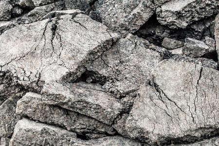 demolished: Photograph of concrete rubble dump, a large pile of demolished concrete blocks.