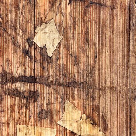 laminated: Old Laminated Flooring Varnished Wood Block-board, Cracked Scratched Peeled Grunge Texture.