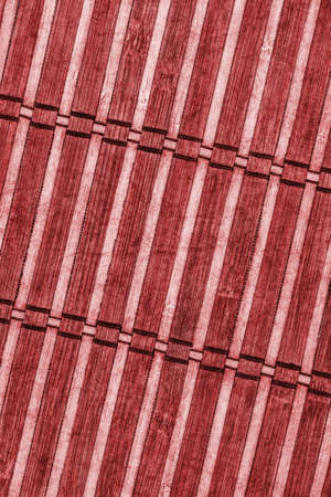 bamboo mat: Bamboo Mat, Bleached and Stained Wine Red, Grunge Texture Sample. Stock Photo