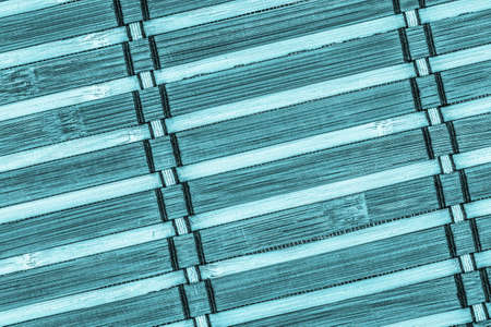 bamboo mat: Bamboo Mat, Bleached and Stained Cyan, Grunge Texture Sample. Stock Photo