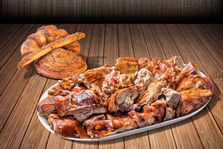 plateful: Plateful of Spit Roasted Pork Slices and Croissant Sesame Puff Pastry Set on Bamboo Place Mat Surface