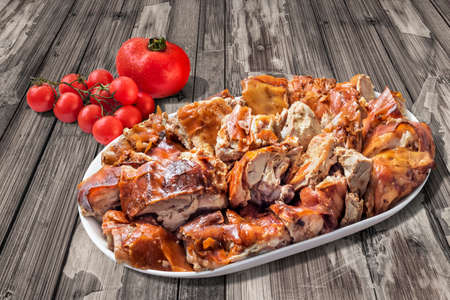 plateful: Plateful of Spit Roasted Pork with Bunch of Fresh Juicy Tomatoes on Old Wooden Garden Table