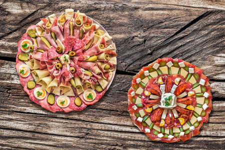 plateful: Plateful of Serbian Traditional Appetizer Savory Dishes Meze set on Old Wood Background