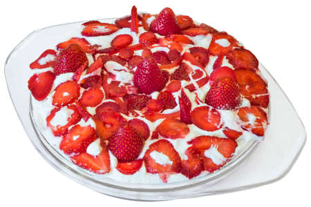 Fruit Cake With Strawberries And Whipped Cream Topping In Glass Platter