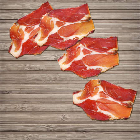 Dry Cured Pork Neck Slices On Bamboo Place Mat