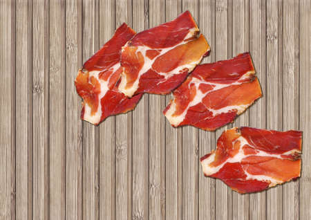 cured: Dry Cured Pork Neck Slices On Bamboo Place Mat