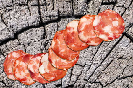 Pork Salami Slices On Old Cracked Stump Rustic Picnic Table Stock Photo